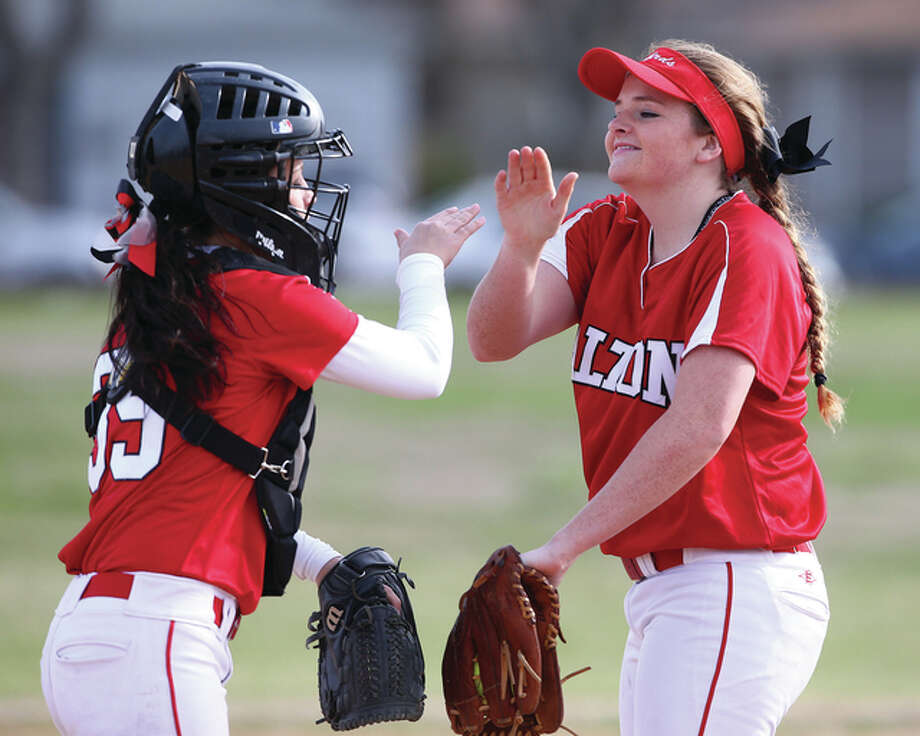 Alton pitcher Brittany Roady (right) and catcher Miranda Hudson celebrated a play during their victory over the EA-WR Oilers on March 22 in Wood River. Roady, Hudson and the Redbirds had more high fives Thursday in Belleville after their 4-2 eight-inning SWC victory over Belleville East. Photo: Billy Hurst / For The Telegraph