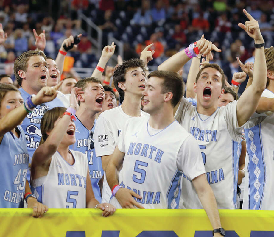 North Carolina fans cheer during Saturday night's national semifinal win over Syracuse in Houston. Photo: AP