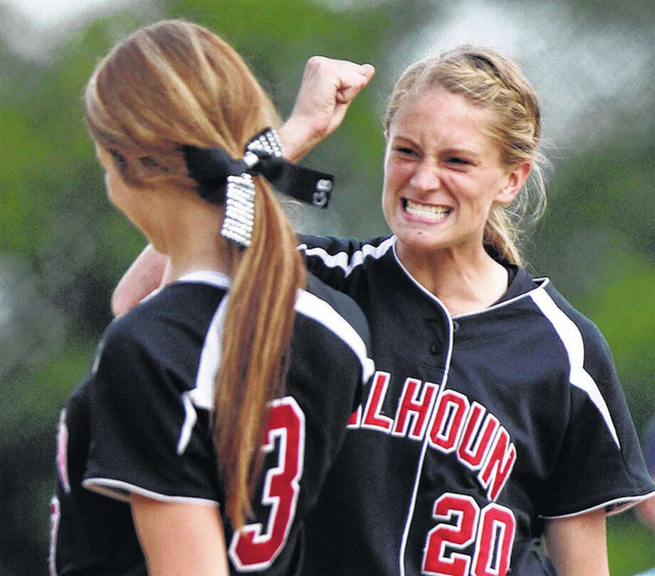 Calhoun third baseman Emma Baalman (right) congratulates pitcher Grace Baalman after a Warriors win in the 2015 Class 1A state tournament in East Peoria. Both return from a 34-4 state championship team ranked No. 1 in the state and seeking back-to-back titles. Photo: Dennis Mathes / Journal-Courier