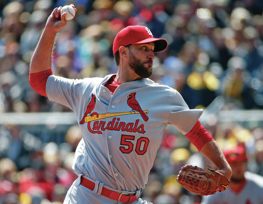 Cardinals starting pitcher Adam Wainwright works during the first inning of the their game on opening day against the Pirates on Sunday in Pittsburgh. Photo: Associated Press