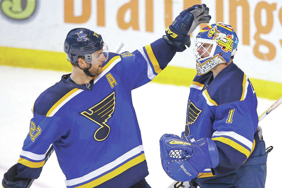 Blues goalie Brian Elliott, right, is congratulated by Alex Pietrangelo after defeating the Arizona Coyotes Monday in St. Louis, 5-2. Photo: Billy Hurst | AP Photo
