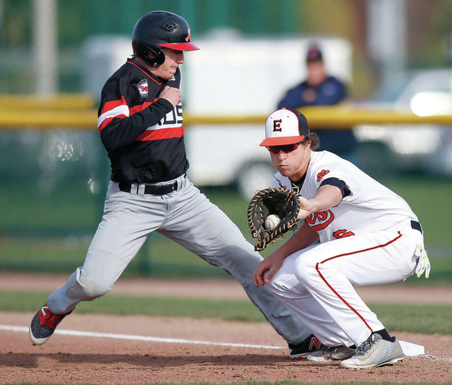 Alton's Matt McDonald (left) gets back to the bag as Edwardsville first baseman Cole Hansel takes the pickoff throw during Southwestern Conference baseball action Tuesday at Tom Pile Field in Edwardsville. Photo: Scott Kane / For The Telegraph