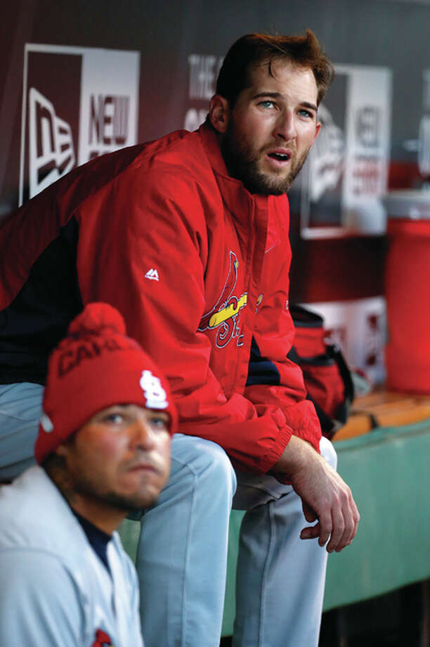 Cardinals pitcher Michael Wacha (right) and catcher Yadier Molina watch from the dugout in the first inning Tuesday night in Pittsburgh. Photo: Associated Press