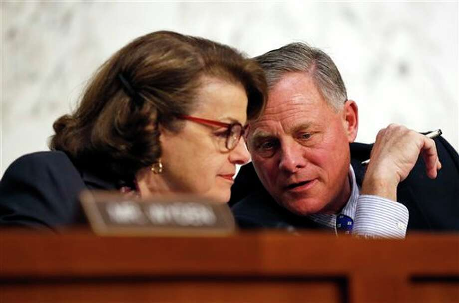 In this Feb. 9, 2016 file photo, Senate Intelligence Committee Vice Chair Sen. Dianne Feinstein, D-Calif., talks with committee chairman Sen. Richard Burr, R-N.C. on Capitol Hill in Washington. A draft version of a Senate bill would effectively prohibit unbreakable encryption and require companies to help the government get access to readable data on a device if theres a lawful search warrant. The draft is being finalized by Burr and Feinstein.