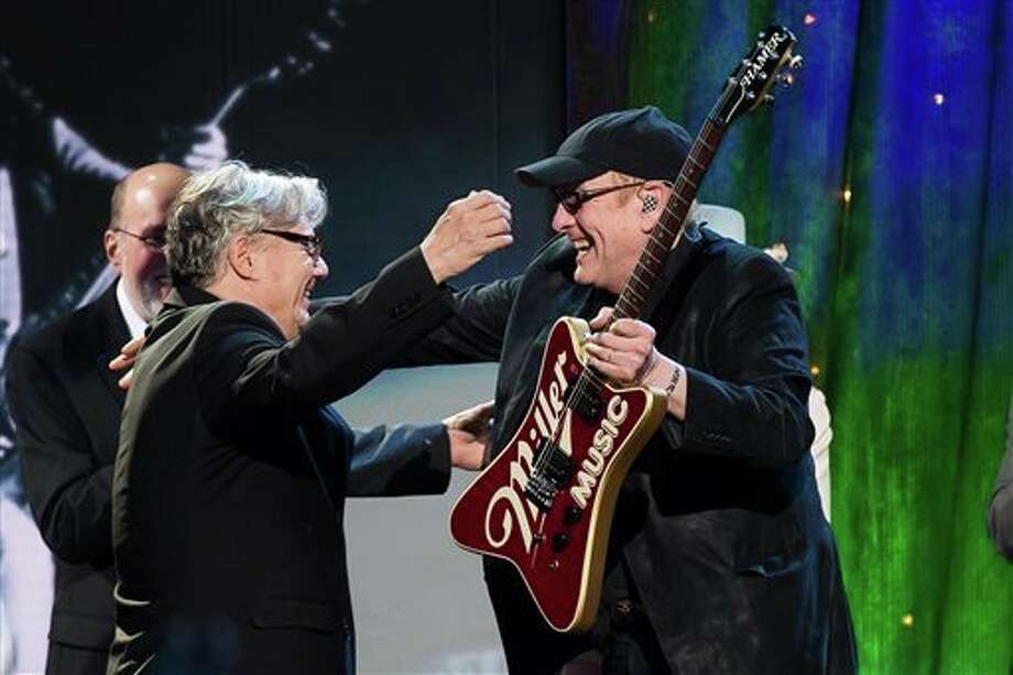 "Rick Nielsen, right, from Cheap Trick gives a ""Miller"" guitar to Steve Miller at the 31st Annual Rock and Roll Hall of Fame Induction Ceremony at the Barclays Center on Friday in New York."