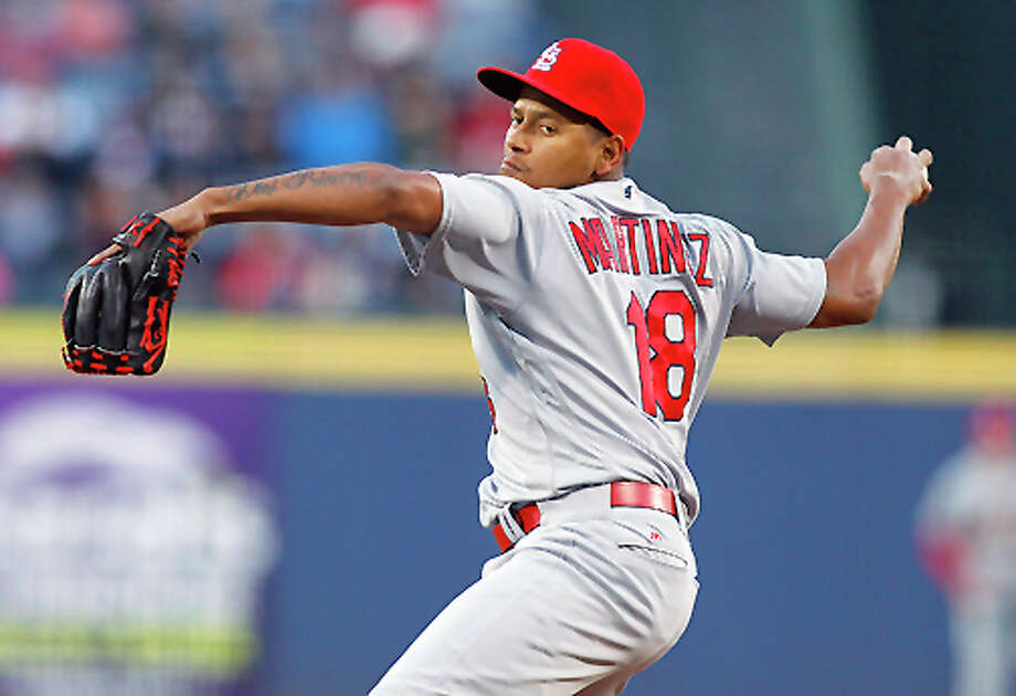 Cardinals starting pitcher Carlos Martinez delivers a pitch against the Braves Saturday night in Atlanta. Photo: AP