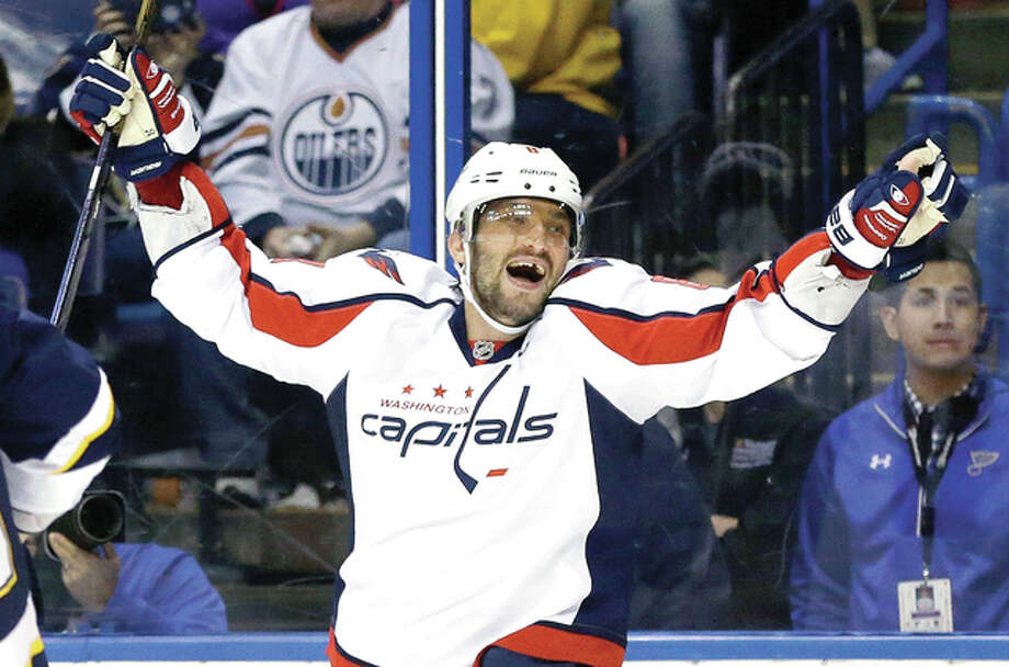 Alex Ovechkin, of the Washington Capitals celebrates after scoring his third goal against the Blues Saturday night in St. Louis. Photo: Jeff Roberson | AP Photo