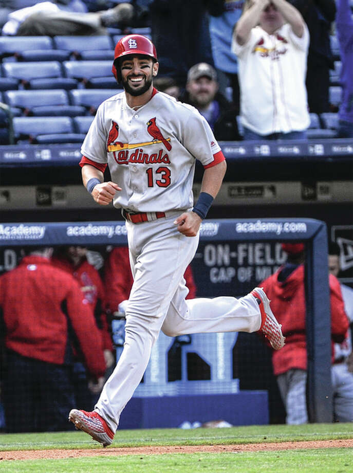 The Cardinals' Matt Carpenter smiles while circling the bases on his three-run home run against the Braves in the ninth inning Sunday in Atlanta. Photo: Associated Press