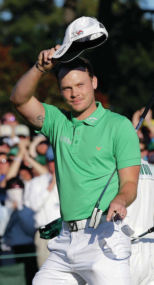 Danny Willett, of England, waves to the gallery after putting out on the 18th hole during Sunday's final round of the Masters in Augusta, Ga. Photo: Associated Press