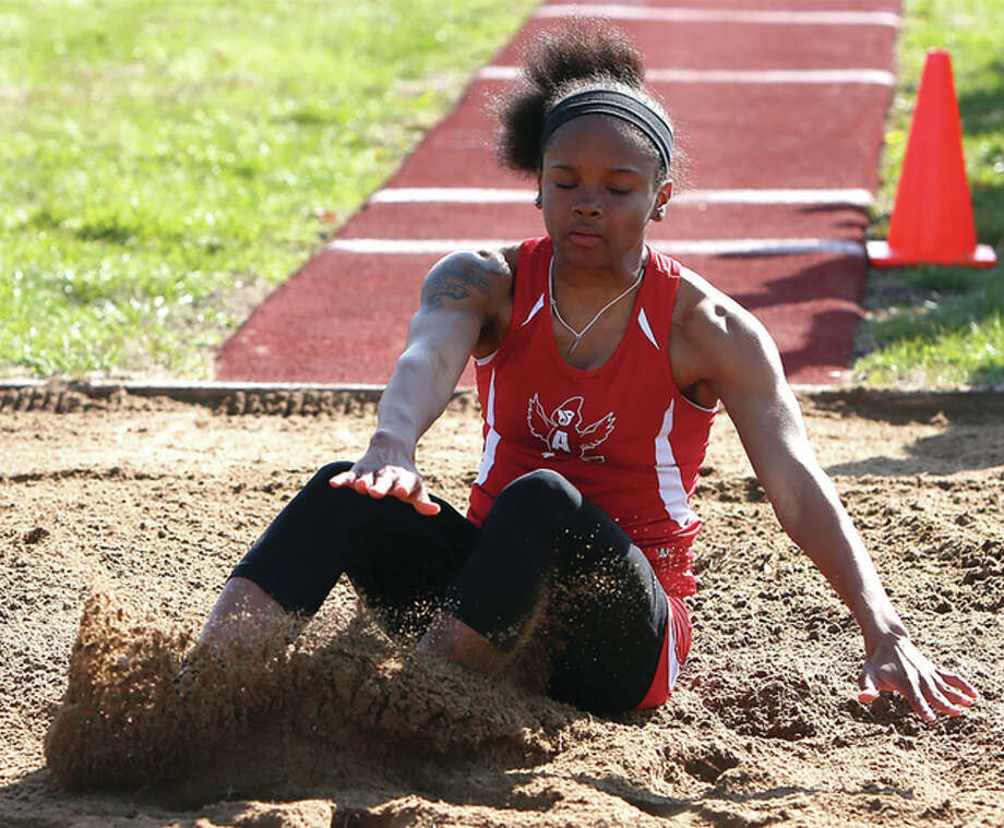 Alton's LaJarvia Brown kicks up sand while competing in the long jump at the Southwestern Illinois Relays on March 26 at the Winston Brown Track Complex in Edwardsville. Brown is the two-time defending Class 3A state champion in the triple jump. Photo: Scott Kane / For The Telegraph