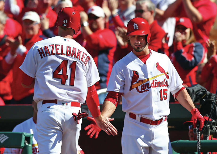 Cardinals left fielder Jeremy Hazelbaker is congratulated by Randal Grichuk (right) after scoring during the first inning of Monday's home opener against the Milwaukee Brewers at Busch Stadium. The Cardinals won the game 10-1. Photo: Billy Hurst | For The Telegraph