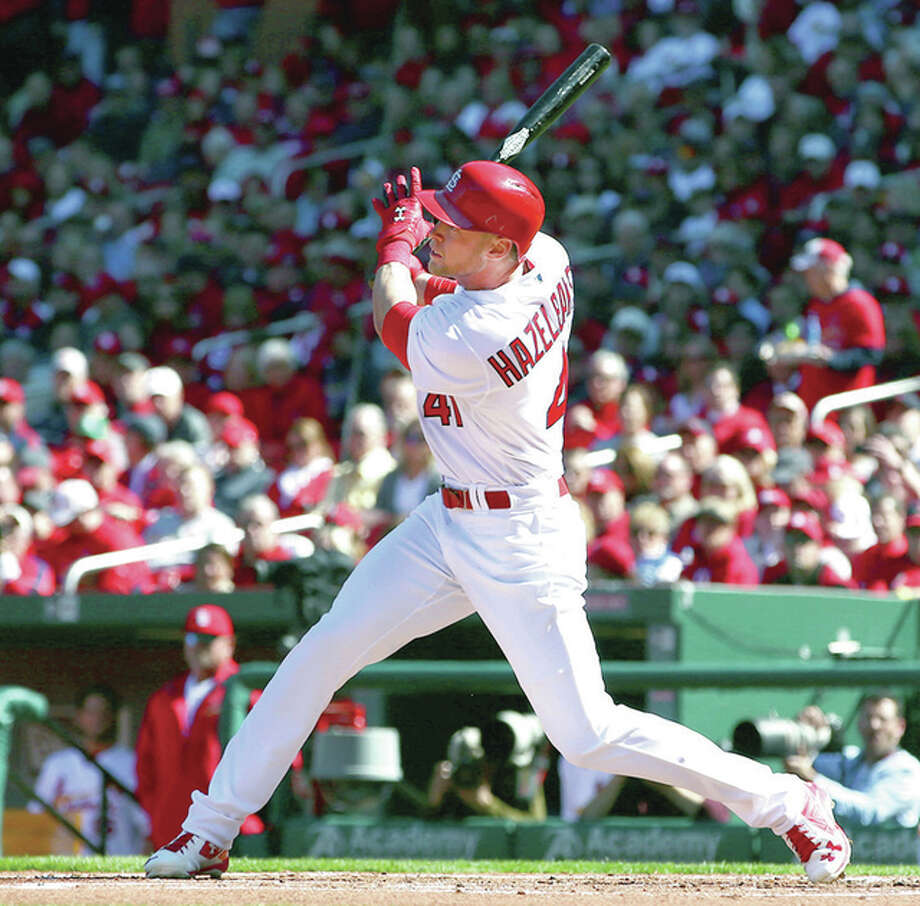 Cardinals left fielder Jeremy Hazelbaker hits a triple in the first inning of Monday's home opener against the Milwaukee Brewers at Busch Stadium. Photo: Billy Hurst | For The Telegraph