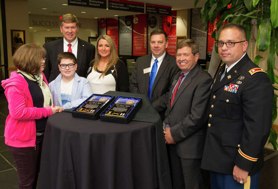 From left, Kaitlyn, Austin and Susie Tipton pose with SIUE's Jeffrey Waple, John Navin, Stephen Hansen, and Lt. Col. Scott Reed.