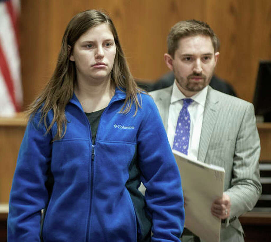 In this Tuesday, April 12, photo, University of Illinois student Lindsay Johnson, 20, walks away from the bench with attorney Tony Bruno during her arraignment at the Champaign County Courthouse in Urbana, Ill. Johnson was charged Monday, April 11 with first-degree murder and other charges after authorities say she suffocated her newborn baby after giving birth in a residence hall bathroom last month.