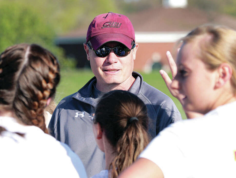 East Alton-Wood river girls soccer coach Matt Herndon gives his team instructions during halftime of Wednesday's game against Carlinville at Wood River Soccer Park. Photo: James B. Ritter | For The Telegraph