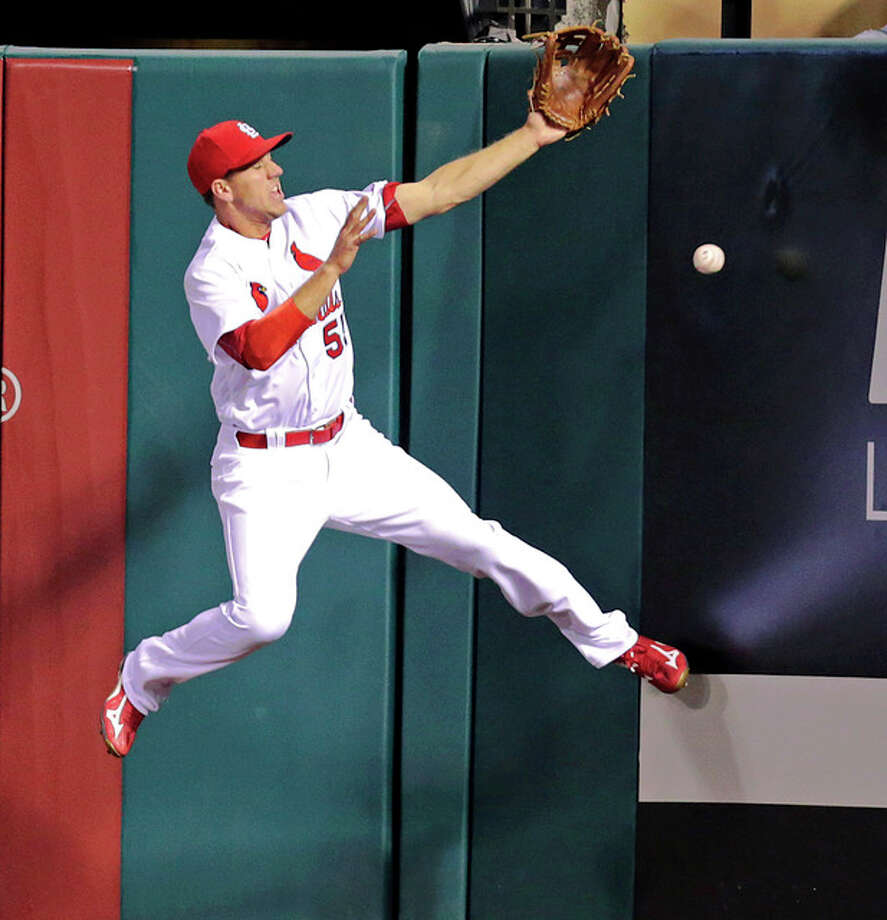 Cardinals right fielder Stephen Piscotty makes a leaping attempt to catch a double by the Brewers' Chris Carter in the fifth inning Wednesday in St. Louis. Photo: Tom Gannam | AP Photo