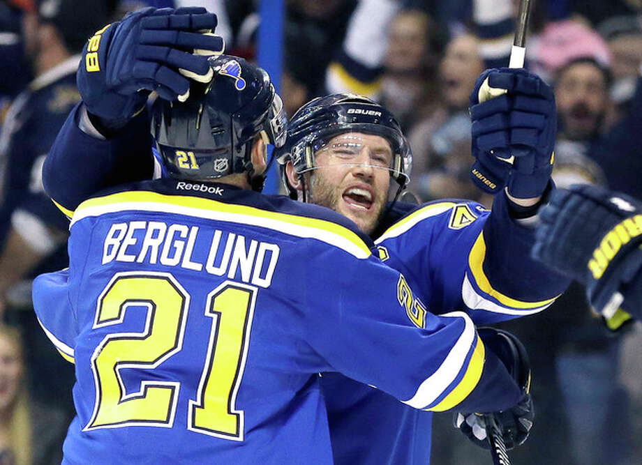 The Blues' David Backes, right, is congratulated by Patrik Berglund after scoring the game-winning goal in sudden-death overtime of Game 1 of their' first-round Stanley Cup playoff series against the Chicago Blackhawks Wednesday in St. Louis. The Blues won 1-0. Photo: Jeff Roberson | AP Photo