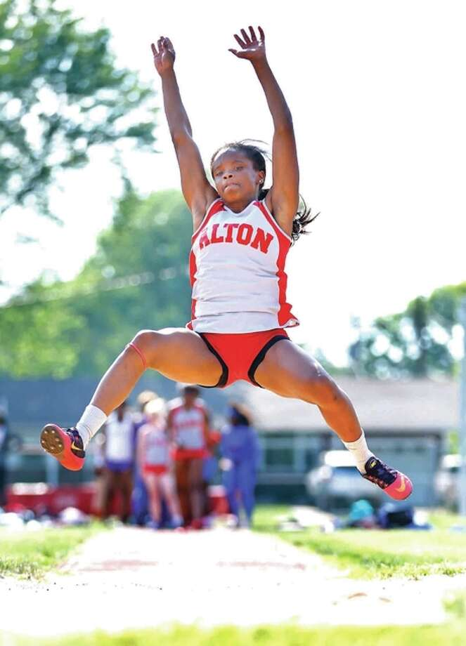 Alton's LaJarvia Brown won three events Wednesday at the Tigers relays at Edwardsville High School. She finished first in the long jump at 19 feet, 3 inches; the triple jump at 40-2 and the 300-meter hurdles in 43.76 seconds. Photo: Telegraph File Photo