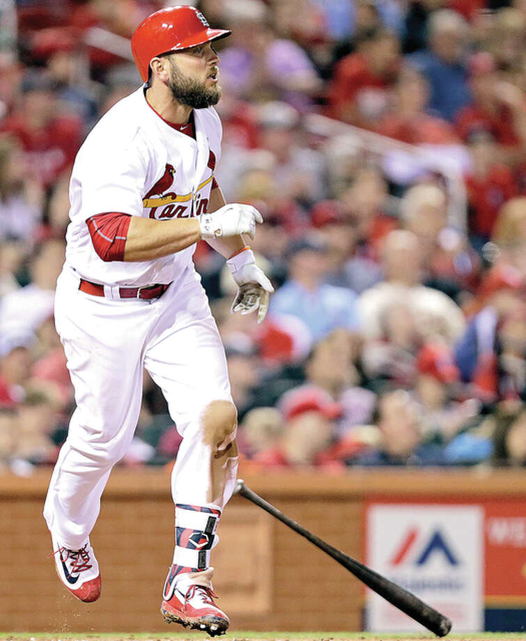 The Cardinals' Matt Holliday watches his home run, his second of the game, in the sixth inning Friday night against the Cincinnati Reds at Busch Stadium. Photo: AP Photo