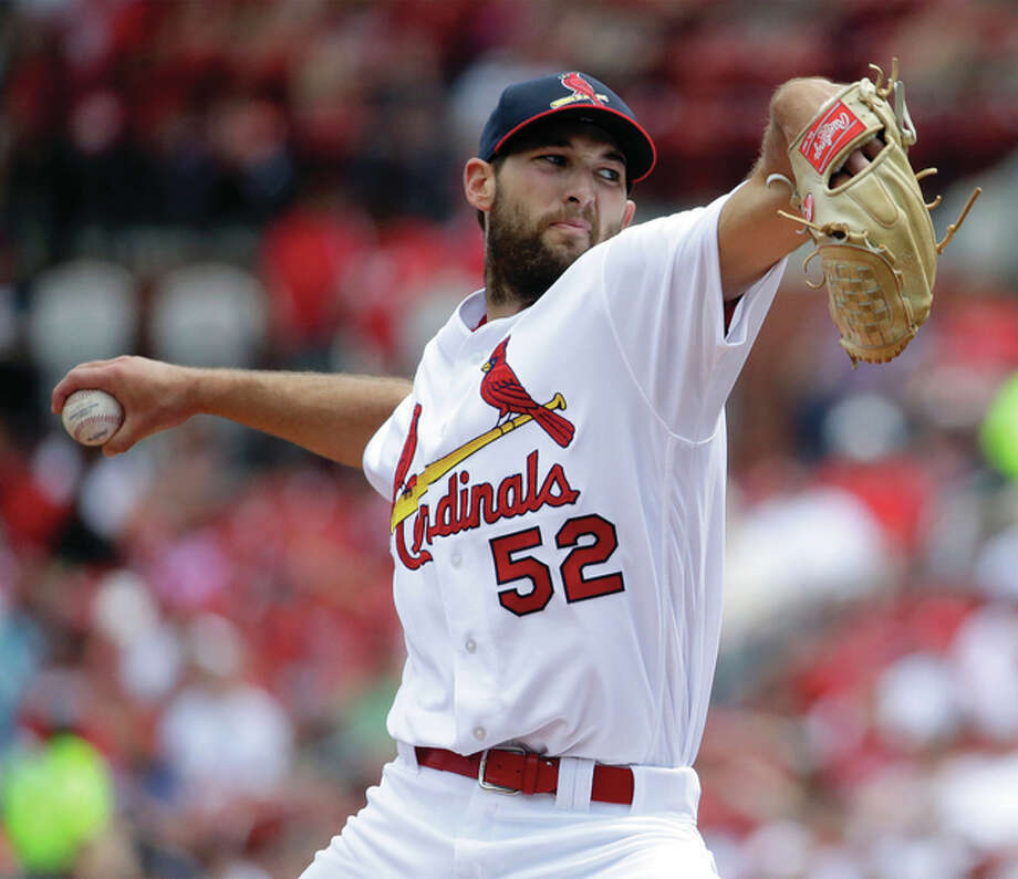 Cardinals pitcher Michael Wacha throws during the first inning of his start against the Cincinnati Reds on Sunday at Busch Stadium. Wacha went six innings for a no-decision. Photo: Associated Press