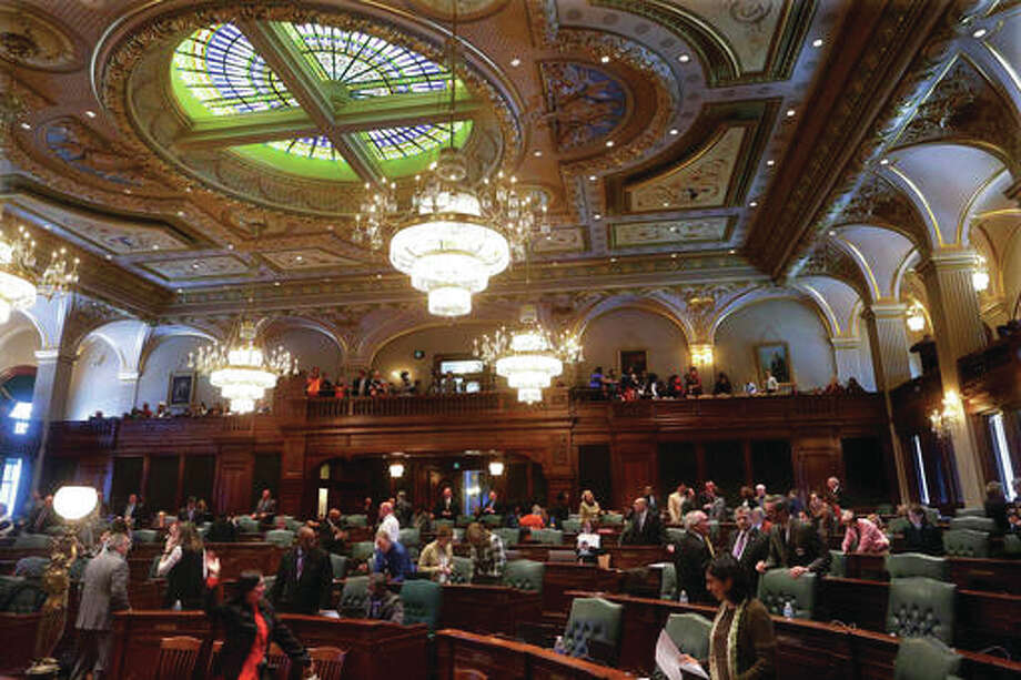 In this Feb. 16 file photo, Illinois House of Representative lawmakers meet on the House floor during session at the state Capitol in Springfield, Illinois. Illinois State University has fared better than most others across the state amid the ongoing budget crisis, according to school officials. Illinois State has been spending below the level authorized by its board of trustees as it waits to see how much money it will receive from the state. The board in October approved a $422 million operations budget under the assumption that there would be a 10 percent cut in state appropriations compared with the previous fiscal year. Photo: (AP Photo/Seth Perlman)
