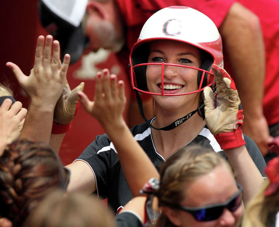 Calhoun's Grace Baalman hit a two-run walkoff home run in the 12th inning to lift her team to a 2-0 win over Alton Monday night in Hardin. She is showing being congratulated after a home run in last season's Class 1A state final. Photo: File Photo By Dennis Mathes, Journal-Courier | For The Telegraph