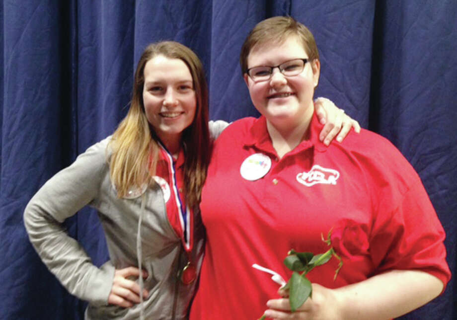 Kaitlyn Zini, left, and Emma Ernst received gold medals at the recent FCCLA state convention in Springfield. Both will be competing in national competition in San Diego in July. A total of 13 Alton High School students attended the convention.