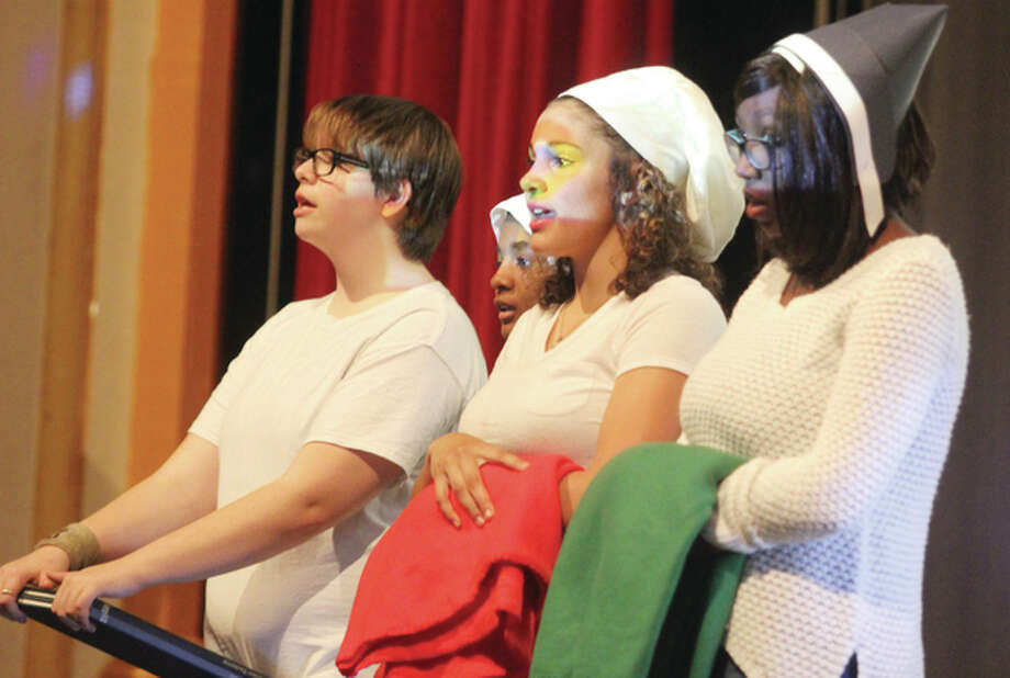 Kathrine Trunbauh, left, Maxine Chanerl, Allyssa Bean and Princella Hayes sing Down to the River to Pray during a presentation of the Alton Middle School 2016 Black History/Women's History Program Monday. The program, which honors both Black History Month and Women's History Month, was presented to AMS students in three performances at the school. The program was originally presented to parents in late March.