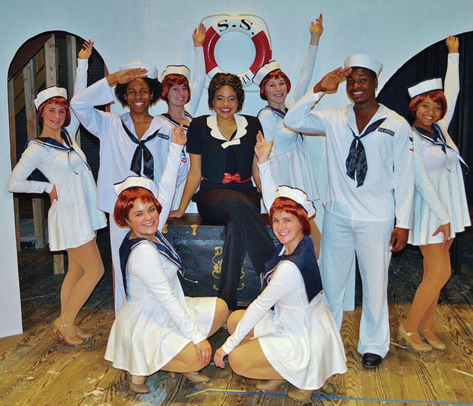 "Reno Sweeney played by Maika Miller, center, sailors Gabriel Generally and Swabu Jefferson, angels in front, Sydney Lombardi and Korby Piel, and in back, Michelle Burns, Alicia Dyer, Annie Maynard and Anya Jones in ""Anything Goes."" Photo: For The Telegraph"