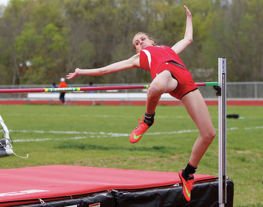 Alton's Katie Mans clears the bar in the high jump Thursday at the Alton Invitational girls track meet at Piasa Motor Fuels Field at Alton High in Godfrey. Mans, a sophomore matched her school record with a leap of 5 feet, 6 inches and then cleared 5-7 to win the event and set a school and meet record. Photo: Scott Kane / For The Telegraph