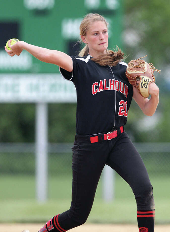 Calhoun third baseman Emma Baalman throws to first base for an out during a game in last season's Class 1A state title run. Baalman is hitting .368 with 28 RBI and four homers for the 22-1 Warriors this season. Photo: Dennis Mathes / Journal-Courier