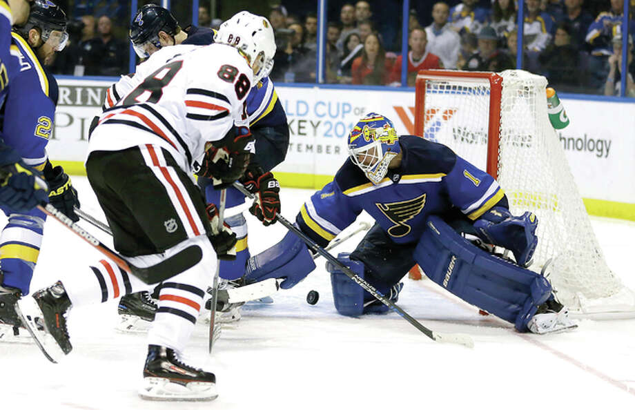 Chicago's Patrick Kane, left, shoots on Blues goalie Brian Elliott in the second overtime in Game 5 Thursday night in St. Louis. Photo: AP