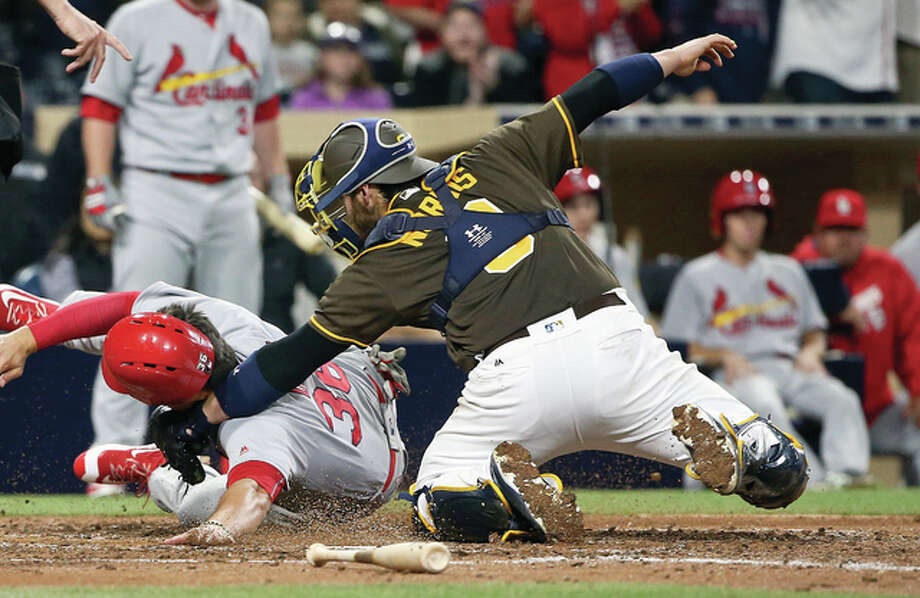 The Cardinals' Aledmys Diazis is tagged out at home by San Diego Padres catcher Derek Norris in the seventh inning Friday night in San Diego. Photo: Lenny Ignelzi | AP Photo