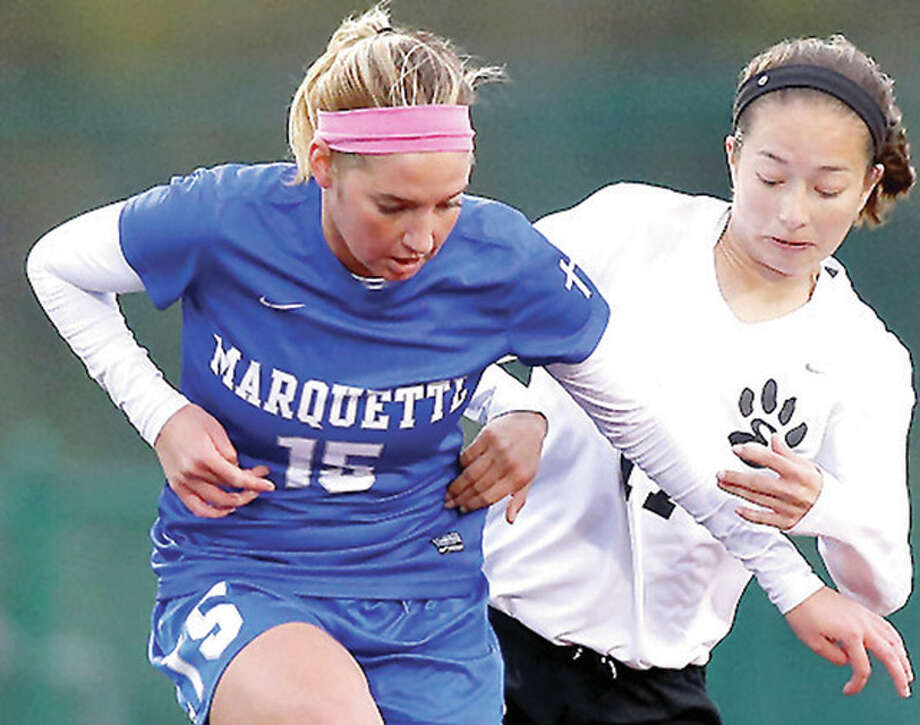 Marquette Catholic's Bailey Hartrich (15) battles Mareea Gaines of Edwardsville earlier this season. Marquette has drawn the No. 1 seed in its postseason sub-sectional.