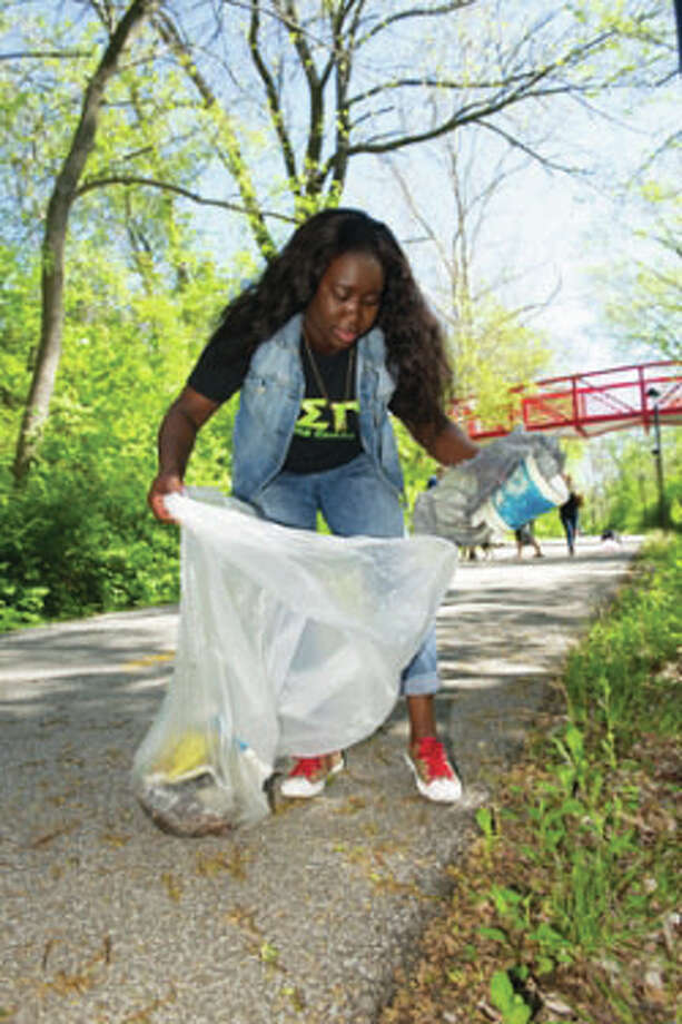 ESG member Love Adantor helps beautify campus on Earth Day. For The Telegraph
