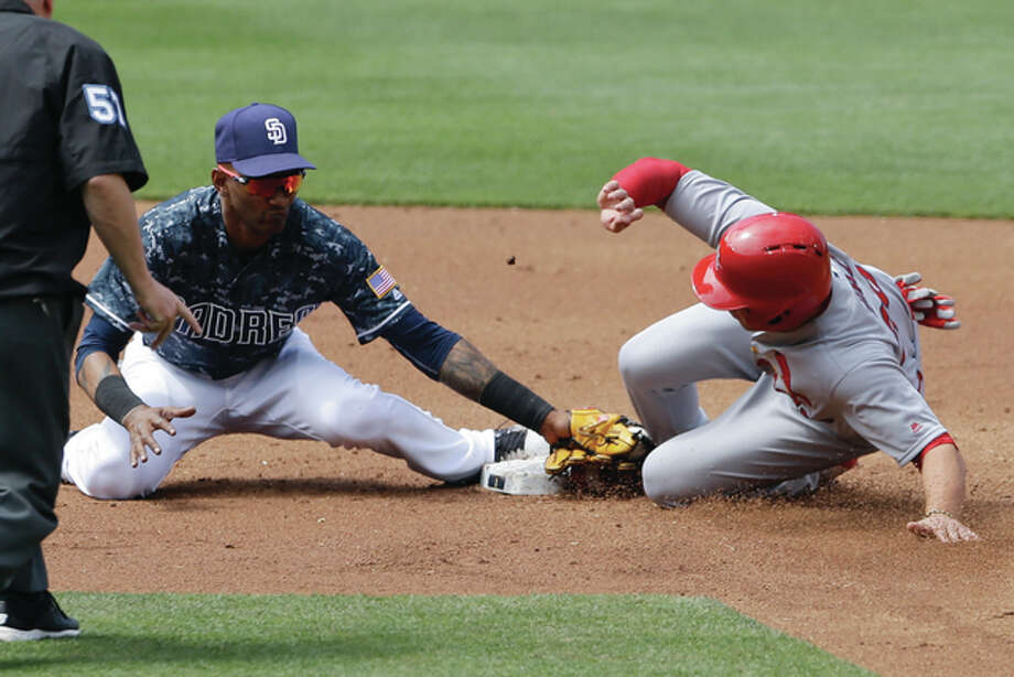 Padres second baseman Jemile Weeks (left) is late with the tag as the Cardinals' Aledmys Diaz safely steals second base during the second inning Sunday in San Diego. Photo: Associated Press