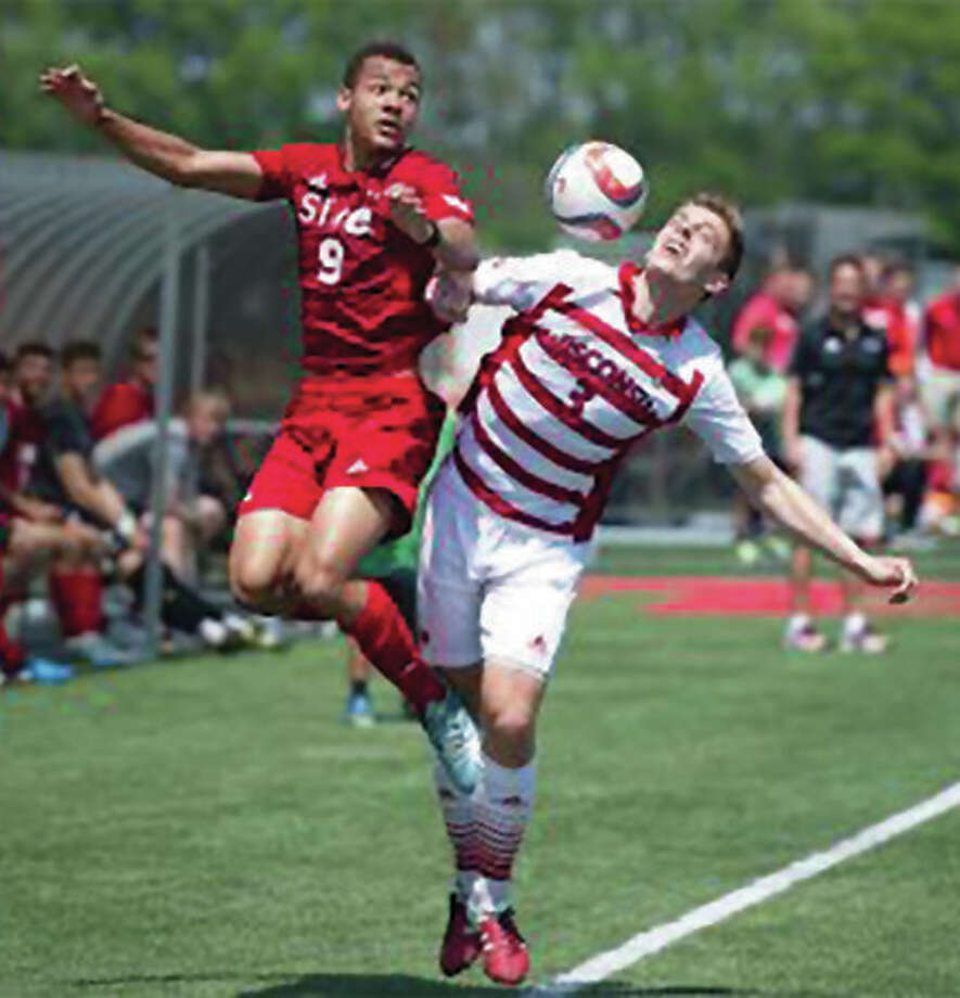 SIUE's Devyn Jambga (left) and Wisconsin's Sam Brotherton compete for the ball during a college men's soccer exhibition match Sunday at Korte Stadium in Edwardsville. The Cougars and Badgers played to a 0-0 draw. Photo: SIUE Athletics