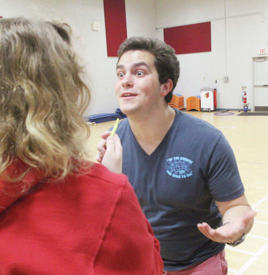 "Principia College theater student Tim Steckler tries to convince his ""sister,"" Alton High School's Anne Sawyer, to give him back his ""weed"" during a rehearsal of ""This is Our Story,"" a joint theater project that will culminate in a free showing at 3 p.m. Sunday at the Jacoby Arts Center."