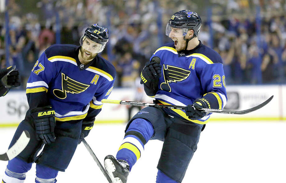 The Blues' Alexander Steen, right, and teammate Alex Pietrangelo celebrate after the Blues' 4-3 victory over the Chicago Blackhawks in Game 7 of their first-round Stanley Cup playoff series Monday in St. Louis. Photo: Jeff Roberson | AP Photo