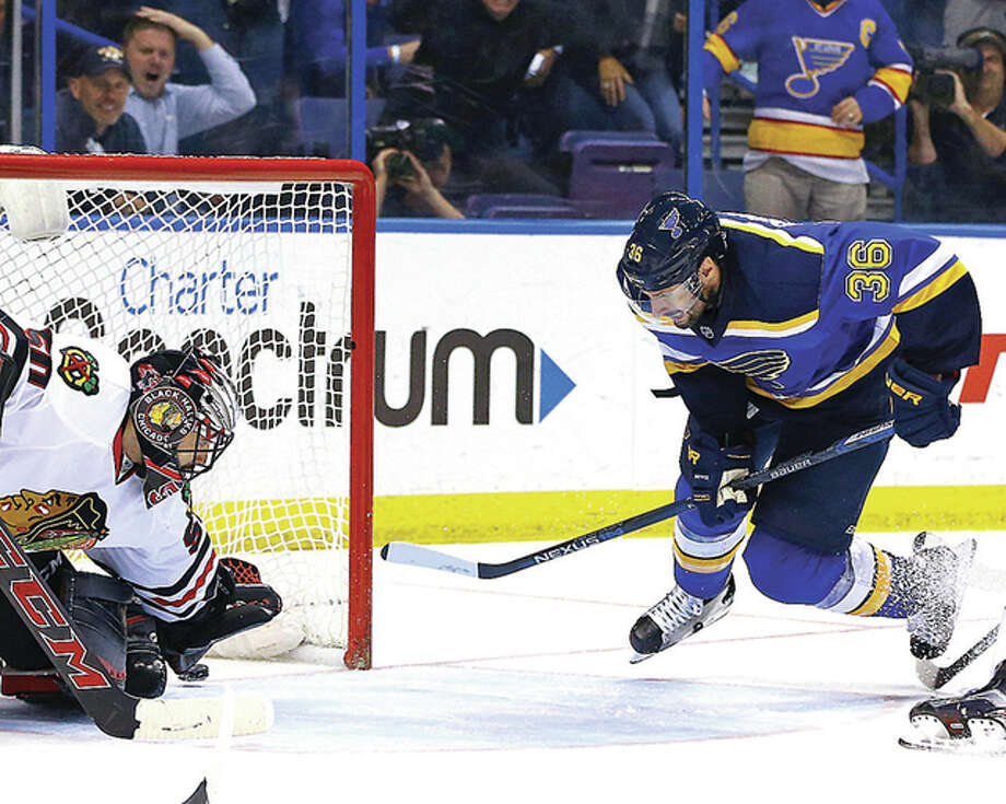 The Blues' Troy Brouwer (36) and goalie Corey Crawford watch Brouwer's game-winning goal Wednesday. Photo: Billy Hurst, CSM | For The Telegraph