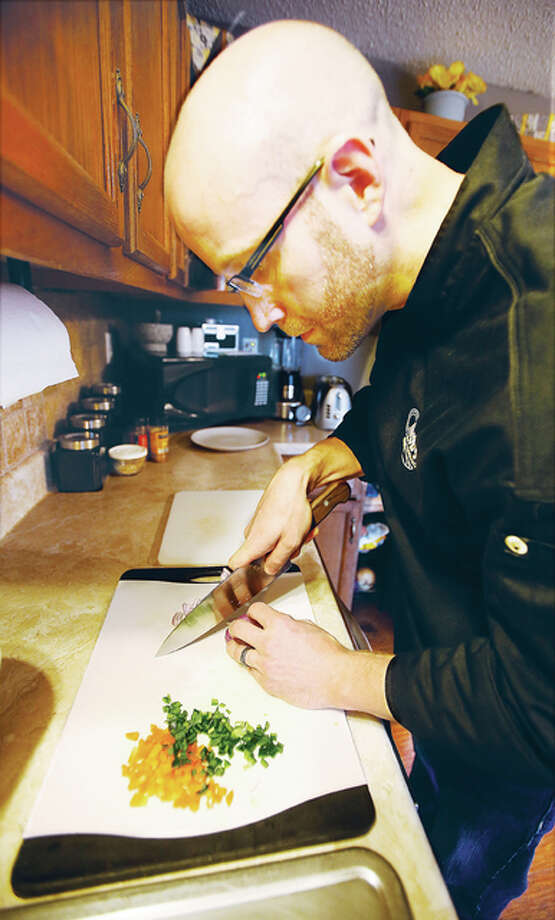 Personal chef Chris Bennett, 33, of Bethalto, found his calling in the culinary arts after serving in the U.S. Marine Corps, which he joined at age 17, after graduation from Alton High School. He recently started his own business ChrisB's Culinary Creations LLC, which is a personal chef service. Photo: John Badman | The Telegraph