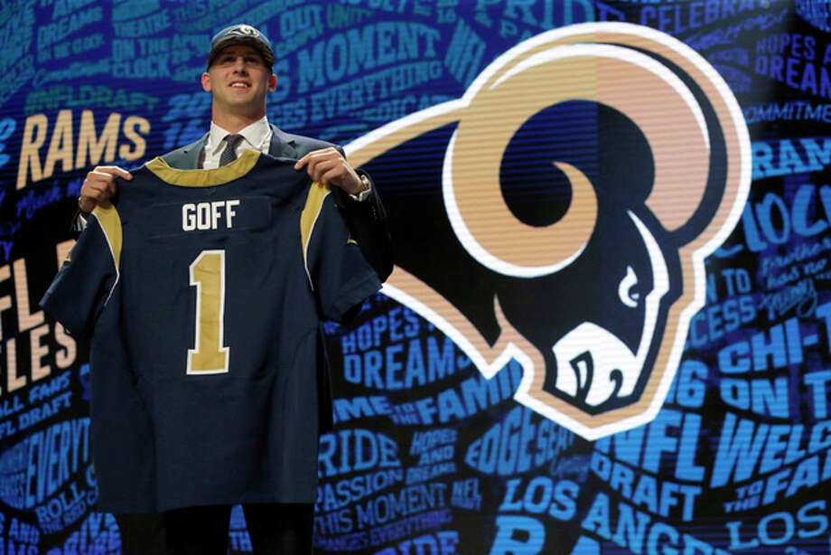 California's Jared Goff poses for photos after being selected by the LA Rams as the first pick in the first round of the 2016 NFL football draft Thursday in Chicago. Photo: AP