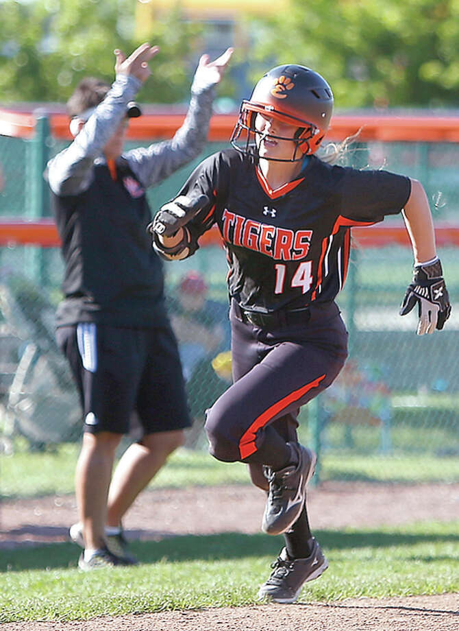 Edwardsville's Rachel Anderson rounds third base and heads for home with Tigers coach Lori Blade in the background during Thursday's 7-0 Southwestern Conference win over Collinsville at the District 7 Sports Complex. Photo: Scott Kane | For The Telegraph