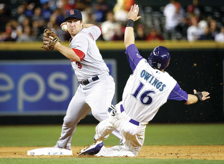 The Cardinals' Jedd Gyorko forces out Arizona Diamondbacks' Chris Owings (16) as he turns a double play on Nick Ahmed in the fifth inning Thursday night in Phoenix. Photo: Matt York | AP Photo