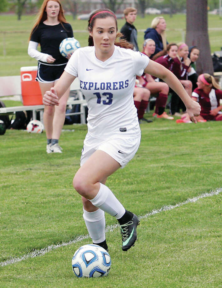 Marquette's Elisa Senno looks to pass the ball as she brings it downfield Friday night against Gibault at Gordon Moore Park.