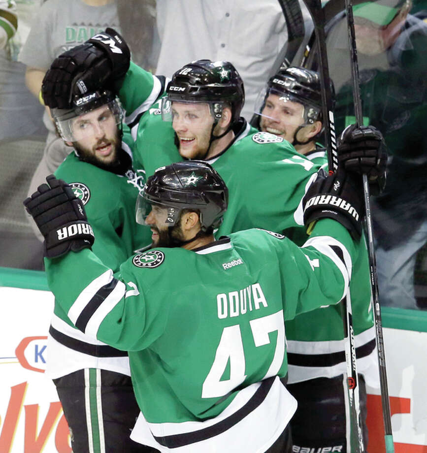 Dallas Stars center Radek Faksa (12) celebrates his goal with teammates Antoine Roussel (21), Jason Demers (4) and Johnny Oduya (47) late in Friday night's Stanley Cup Playoff series winover the Blues. Photo: AP AP