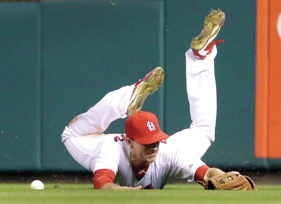 Cardinals right fielder Stephen Piscotty dives but cannot catch a fly ball by Washington Nationals' Danny Espinosa in the ninth inning of Friday night's game in St. Louis. Photo: Jeff Roberson | AP Photo