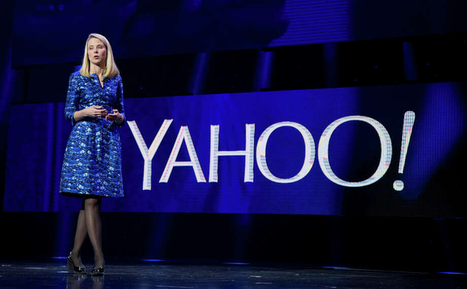 In this Jan. 7, 2014, file photo, Yahoo president and CEO Marissa Mayer speaks during the International Consumer Electronics Show in Las Vegas. Mayer will walk away with a $55 million severance package if the company's auction of its Internet operations culminates in a sale that ousts her from her job. The payout disclosed in a Friday, April 29, 2016, regulatory filing consists of cash, stock awards and other benefits that Mayer would get should she be forced out as CEO within a year after a sale.