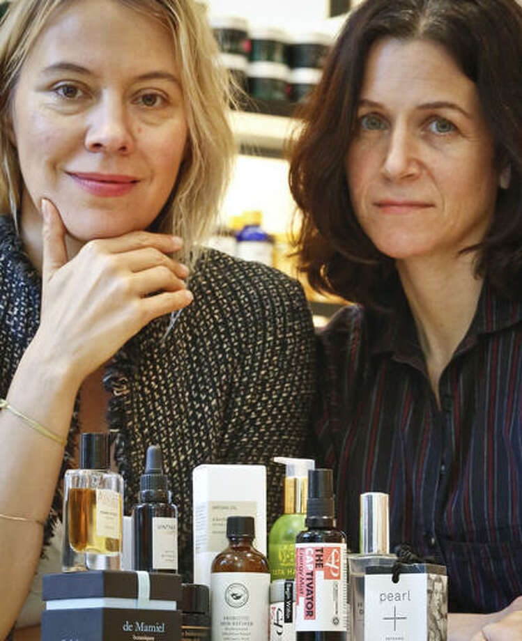 Kerrilynn Pamer, left, and Cindy DiPrima Morisse, owners of CAP Beauty, a wellness store with an all-things-natural approach, pose with products sold at their store in New York's West Village. The makeup industry is trying to convince women that looking good on the outside starts from within, but it's unclear if the products they're trying to hawk are safe and effective.