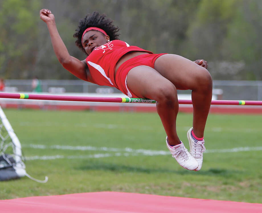 Alton freshman Cri-shonna Hickman gets over the bar during the high jump competition at the Alton Invitational on April 21 at Alton High. Hickman came back Friday to win her first major-meet title by clearing 5 feet, 4 inches at the Collinsville Invite. Photo: Scott Kane / For The Telegraph